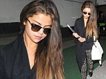 Sexy Selena! Ms Gomez alights from a long haul flight sporting perfect skin and shining hair... (she's even wearing Chanel loafers)
