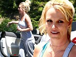 In need of a pick-me-up! Make-up free Britney Spears looks weary as she clutches energy drink at dance studio