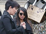 Shouldn't you be doing that with Kanye? Kim Kardashian and Kris Jenner perform traditionally romantic lock ceremony