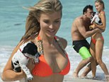 Puppy love! Stunning Joanna Krupa plays with adopted pooch Darla on the beach with her fiance Romain Zago... who can't decide who he'd rather smooch
