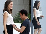 Just a little tweak and tuck: Jennifer Garner as her outfit adjusted as she films Draft Day on location in Ohio