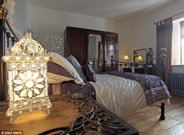Romance in the lighthouse: The bedroom in the main house on the property