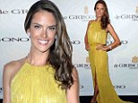 Alessandra Ambrosio arrives at Cannes Film Festival in a lime green gown covered in sequins