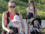 That's what you call multi-tasking: Guy Ritchie's fiancee Jacqui Ainsley balances her son and daughter