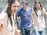 A soaked Katie Holmes frollicks in fountain with co-star Luke Kirby on the Mania Days set where she's already 'been asked out seven times'