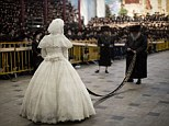 Rare occasion: Thousands of Hasidim Jews dressed in black watch as an Ultra Orthodox Jewish rabbi dances with the bride during the Mitvah tantz ritual