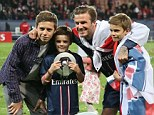 Family ties: David Beckham posing with his sons after PSG won the French league
