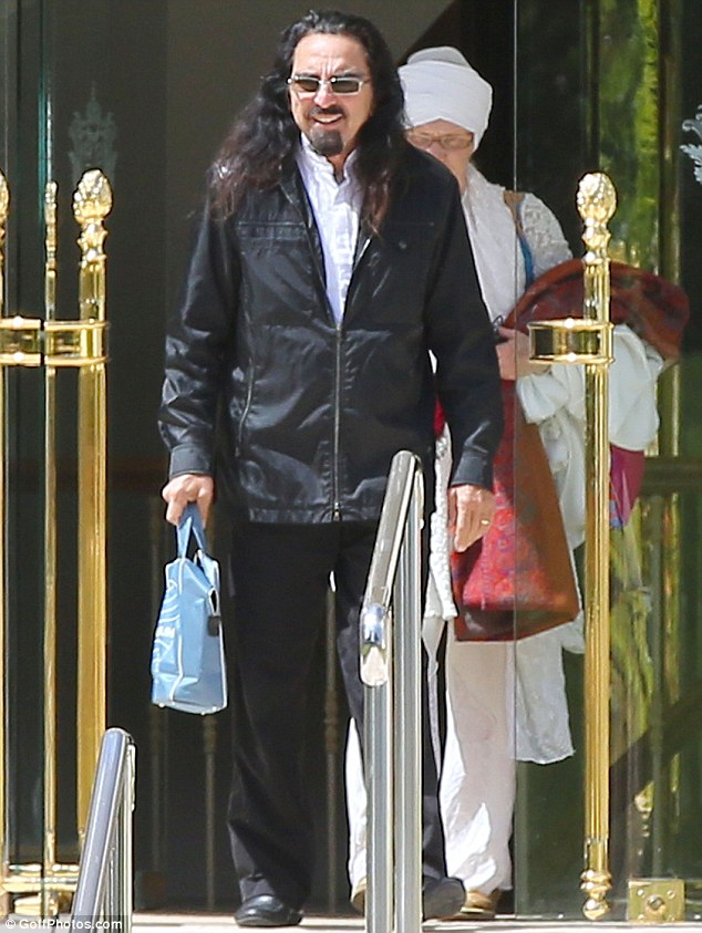 Proud father: George DiCaprio left the Eden Roc Hotel in France on Tuesday during the 66th Cannes Film Festival that included a screening of his son Leondardo DiCaprio's new movie The Great Gatsby