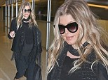 Pregnant Fergie opts for all-black outfit as she arrives in New York... after Black Eyed Peas bandmate lets slip she's 'having a girl'