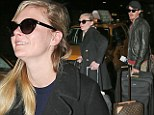 Long ride home: Kirsten Dunst and Garret Hedlund arrive in NYC with post-Cannes exhaustion