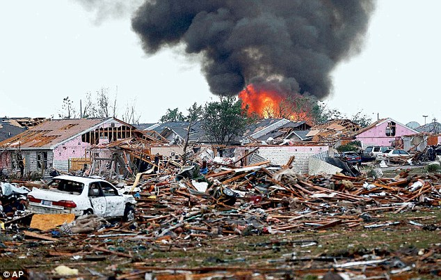 Moore: A fire burns in Moore following Monday's tornado