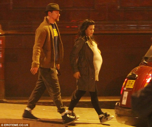 Calling it a night: The pair strolled down the road to catch a cab after watching the movie]