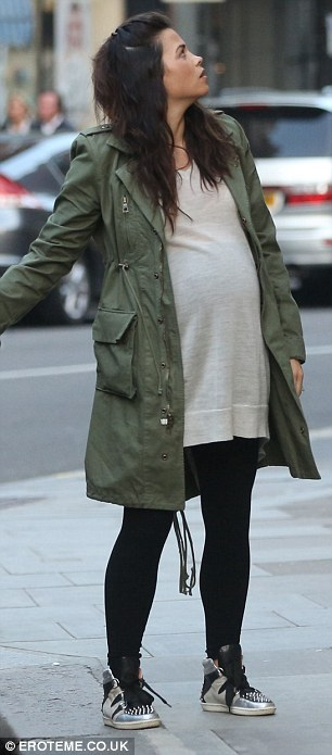 Blooming: Jenna wore a jumper dress over leggings with metallic trainers and a khaki jacket for the outing
