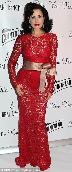 Old Hollywood glamour: Dita styled her hair in retro waves as she sported a bright red pout and vintage-inspired earrings
