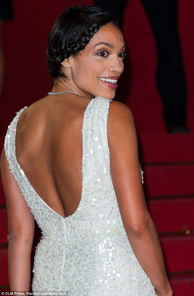 Smiling it off: Rosario brushed off the incident with a smile as she continued to climb the famous Cannes stairs