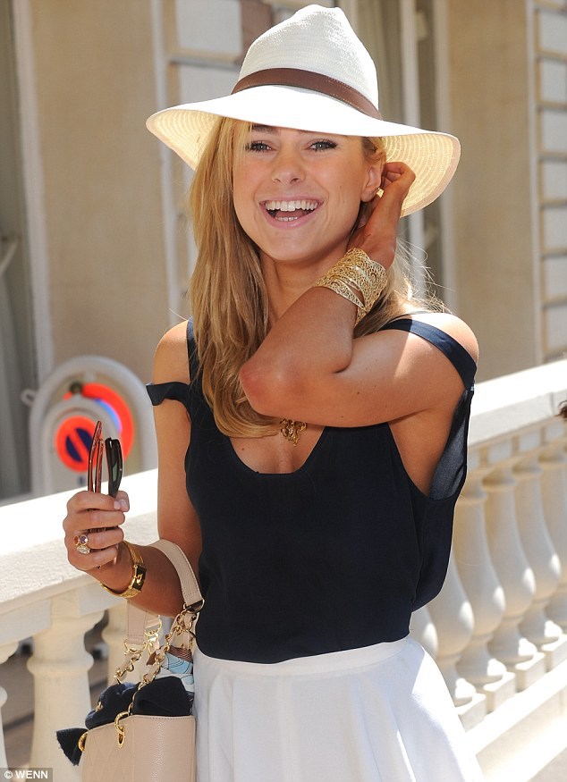 Hello sunshine! Kimberley beamed with delight as she made a stylish arrival in Cannes