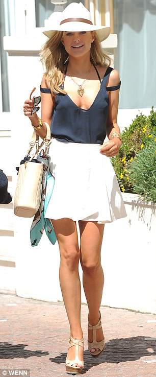 Dressed to impress: Kimberley teamed her outfit with a pair of sky-high heels, hat and sunglasses