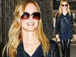 Heather Graham is all smiles as she arrives at Los Angeles International Airport to catch a flight out of town