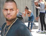 So ARE they back together? An angry Chris Brown rear ends another car...and ex Karrueche Tran is with him