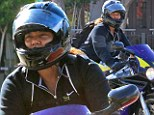 Power between her thighs! Queen Latifah takes her purple and yellow motorcycle for a ride in West Hollywood