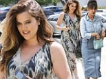 Winning the style wars! Khloe Kardashian triumphs in flattering florals as Kourtney struggles in too-trendy double denim