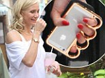 Taking catfights to the next level... with a knuckleduster? Cameron Diaz giggles on the set of her current film as she carries a knuckleduster iPhone case