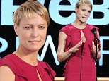 A Webby win: Robin Wright looks ravishing in red as she awards House of Cards co-star Kevin Spacey at the 17th Annual Webby Awards