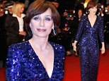 Showing them how it's done! Kristin Scott Thomas, 52, slips into plunging blue gown for Cannes premiere of Only God Forgives