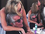 Spot the single millionaire! Fashion designer Roberto Cavalli, 72, gets a hug from Sharon Stone as he lives the high life on his yacht at Cannes