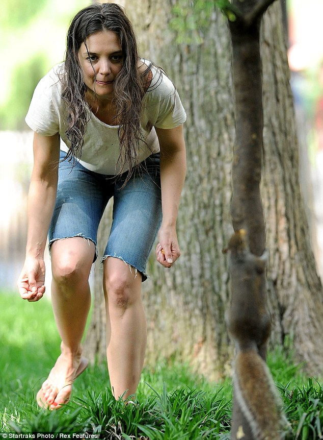 Playing with a squirrel: Katie later got deeper into her wild Mania Days character while chasing a squirrel in the park