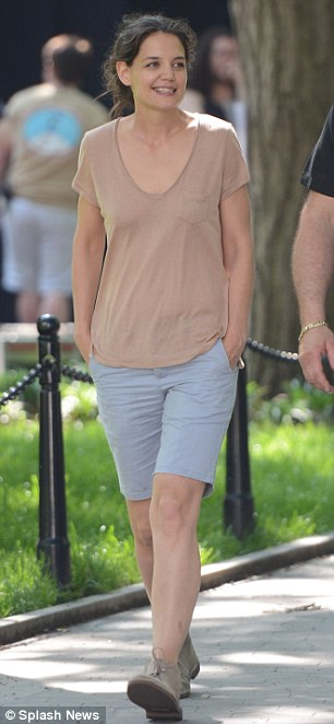 Drab: Katie was wearing the same tee but she had on different knee-length blue shorts and matching beige boots