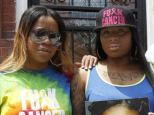 Makia Underwood, left, and sister Zakia Clark, along with their uncle Curran Underwood, right, wear their anti-cancer gear in Philadelphia, on May 21