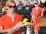 Getting her daily dose! Reese Witherspoon brightens the day in orange frock to stock up on flowers