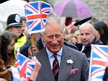 Prince Charles, pictured as he is welcomed into the historic town of Hay on Wye had to sit through a 'hairy' mid-air drama today when the royal helicopter was forced to divert to a nearby aerodrome