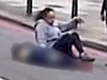 The angel of Woolwich: A woman sits next to the dead soldier after the brutal killing while two other women calm the situation