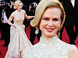 Life imitates art: Nicole Kidman pays homage to Grace Kelly in elegant cream gown for Cannes premiere