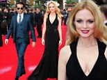 All eyes are on Heather Graham as she dons plunging black gown to join Bradley Cooper on the red carpet at Hangover 3 premiere in London
