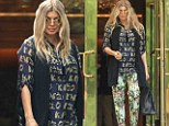 Fergie teamed her tiger top with botanical print trousers in New York