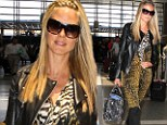 supermodel looked picture perfect as she strutted through LAX on Wednesday in a fashion-forward ensemble.