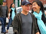 Smiling games: A cheerful Woody Harrelson walks hand in hand with his wife in New York