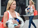 Fur-get about it! Katrina Bowden flaunts her new wedding ring as her puppy refuses to walk on his own