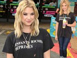 You could have made an effort! Ashley Benson is dishevelled in holey T-shirt and jeans as she sips Slurpees at 7-Eleven event