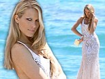 That's a sight for sore eyes! Petra Nemcova shows off her tanned and toned body in a backless lace dress for Cannes photo shoot