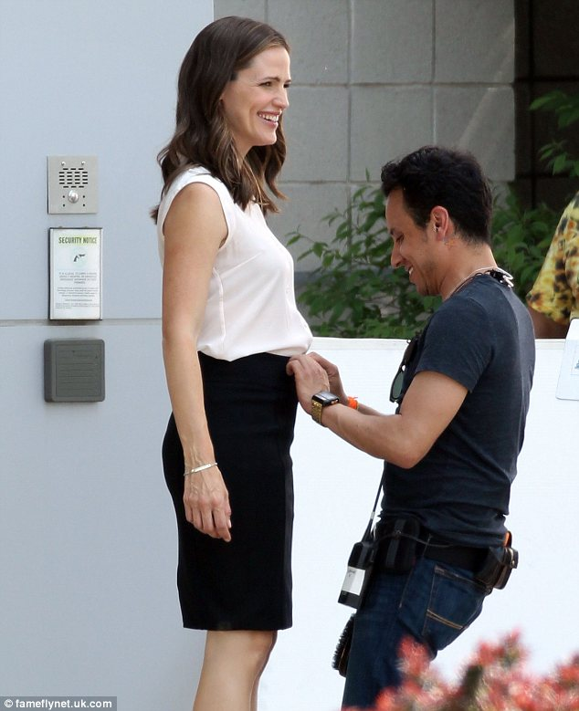 Last minute tweaks: Jennifer Garner was seen being attended to by an assistant on the set of Draft Day in Ohio on Monday