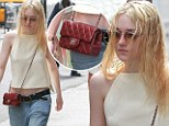 Everything goes with Chanel! Dakota Fanning dresses down in baggy jeans and wet hair... but adds a touch of class with her designer bag