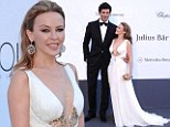 Mi amour! Kylie Minogue looks as sexy as ever in plunging white gown as she hits red carpet with boyfriend Andres Velencoso at amfAR