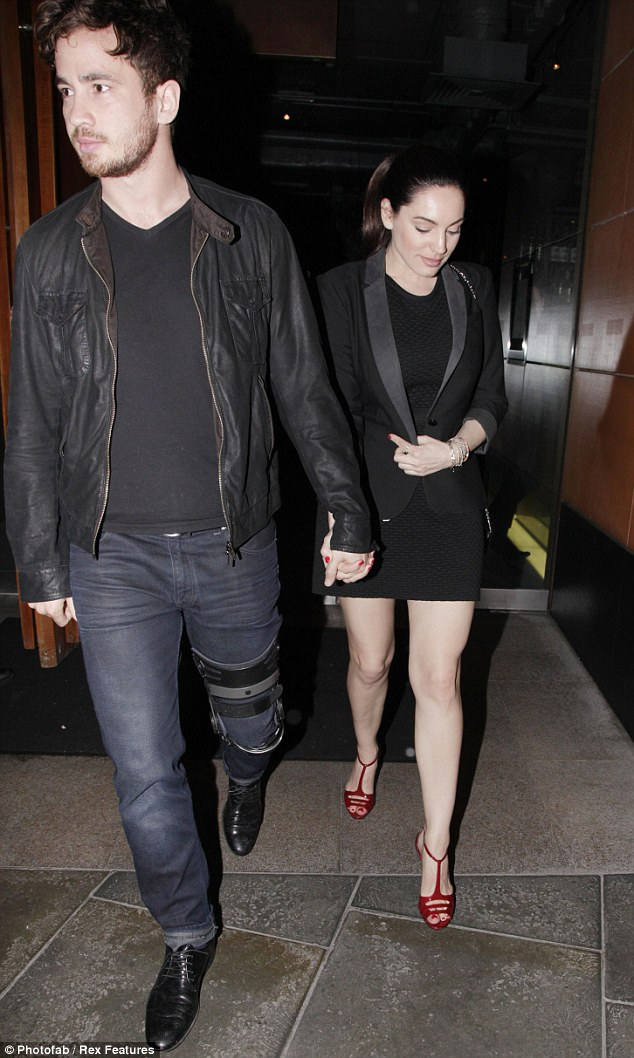 His and hers: While Danny was rather casually dressed Kelly made the effort in a tight and short black dress