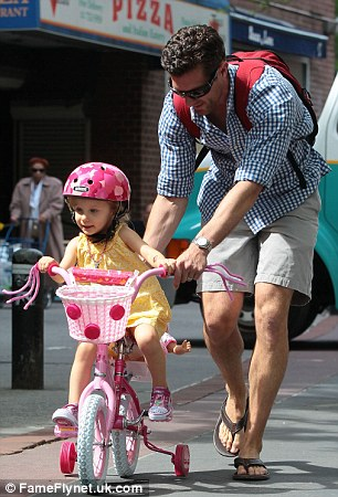 Let's go faster! Three-year-old Bryn looked to be having the time of her life as her father helped her navigate the training-wheel equipped bike