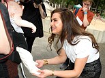 Touchy-feely: The actress got to grips with a young baby at the gathering