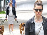 Girl's best friends! Jessica Biel sports curve-hugging stripes as she takes her beloved pups for a walk in New York City